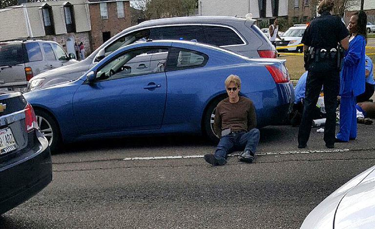 Ronald Gasser next to his car after Joe McKnight, the former N.F.L. player, was shot and killed in Terrytown, La., last year. CreditMarie Turner/Associated Press