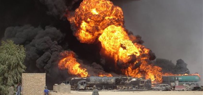 FILE - In this Tuesday, Sept 11, 2007 file picture, plumes of fire and smoke fill the sky after a suicide car bomb explosion which hit fuel tanker trucks on the main highway of Helmand province, south of Kabul, Afghanistan. (AP Photo/Abdul Khaleq, File) (AP)