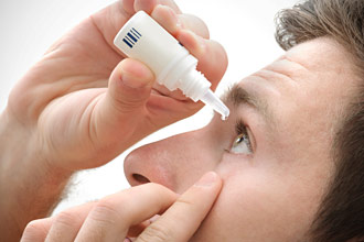 man-uses-eye-drop-330x220.jpg