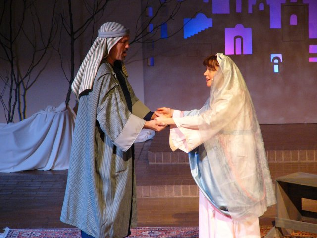 "Mary and Joseph singing, ""May God give life""."
