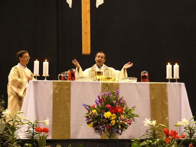 Fr. Joe sings the Eucharistic prayer.