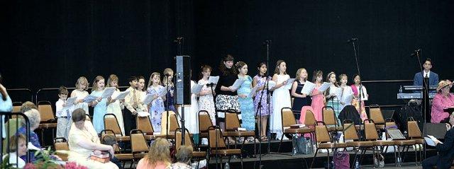 The children's choir sings during the prelude.