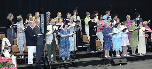 A hard working adult choir sings praise to God!