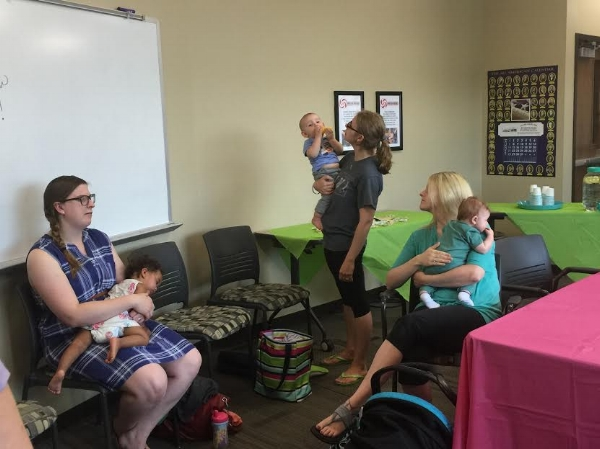 WIC Peer Counselor, Amanda Perkins, connects with area moms and their babies at Operation Threshold.
