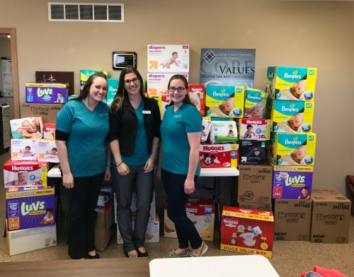 Affiliate NEID Doulas, Jessica Lake and Justine Liddle with NEID Owner, Kaity Klotzbach at Cedar Valley Friends of the Family in Waverly.