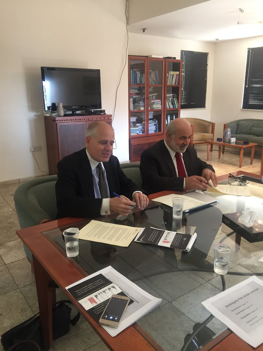 Two of Syada Awalan's partners, Dr. Musa Shteiwi (Director of the University of Jordan's Center for Strategic Studies), and Dr. Eric Wolterstorff (Sovereignty First) sign their memorandum of understanding.