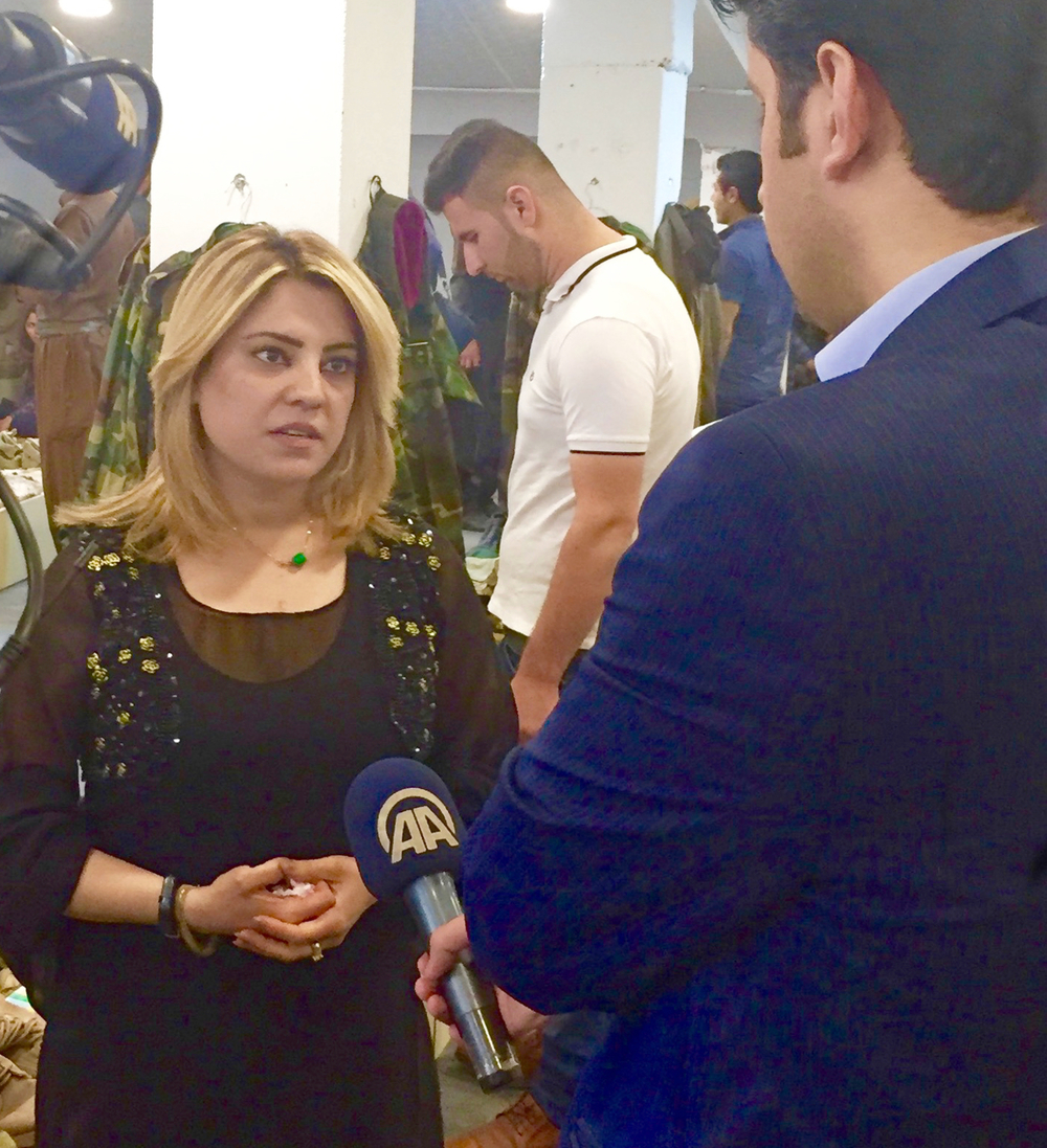 Kurdish journalist Friyal Faisal being interviewed by a local news network. May 2016