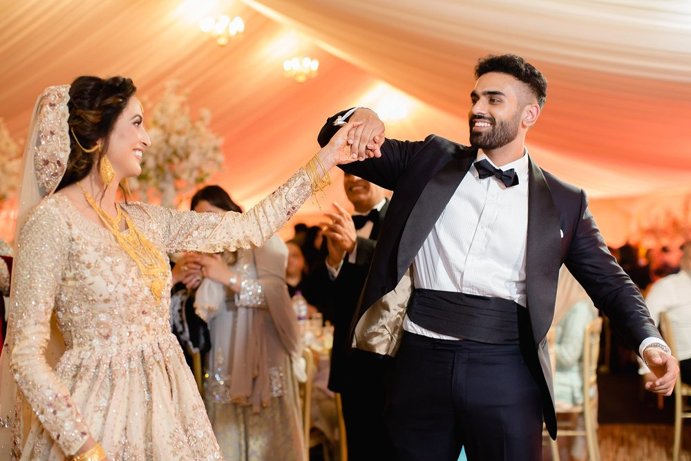Pakistani couple dancing at Walima Wroxhall Abbey Coventry