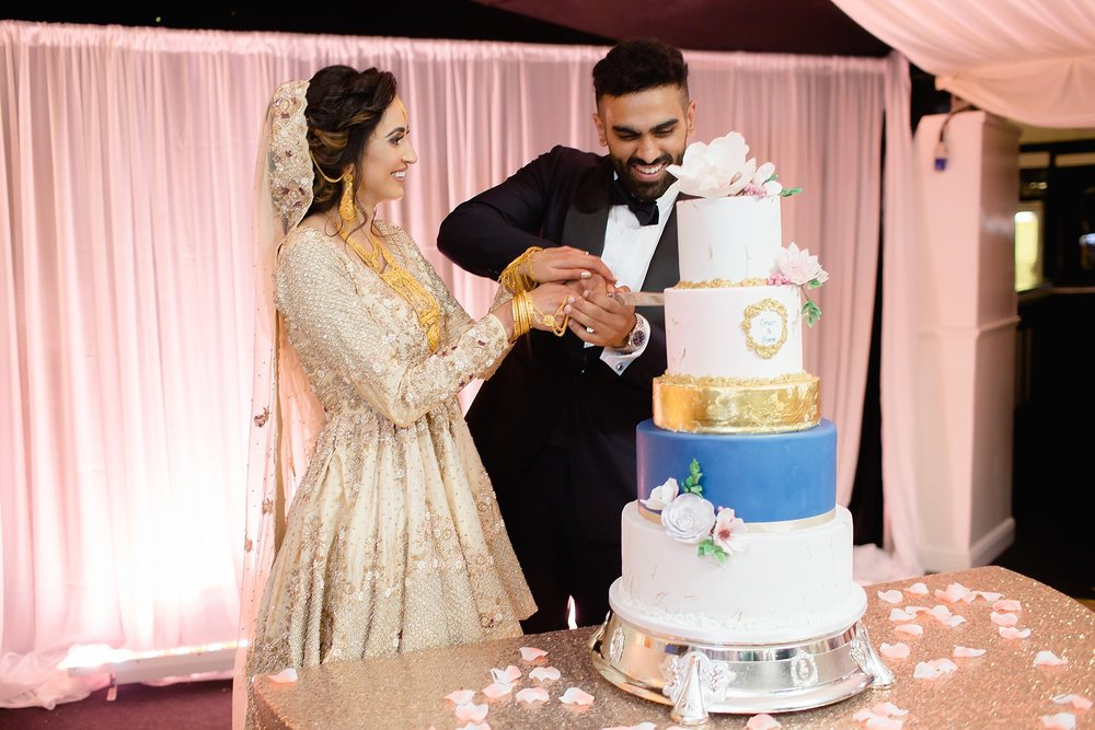 Pakistani couple cut cake at Walima Wroxhall Abbey Coventry