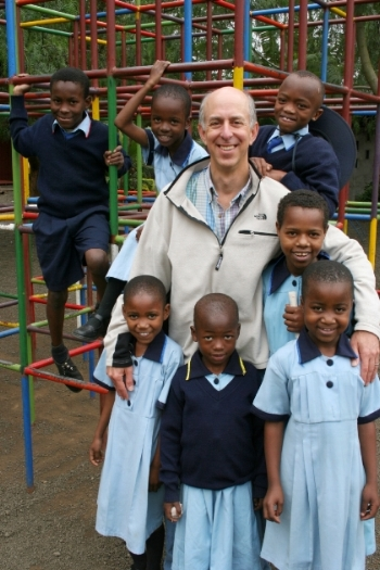 Bob Treitman spending some time with the children of Tanzania during a visit to Tanzania.