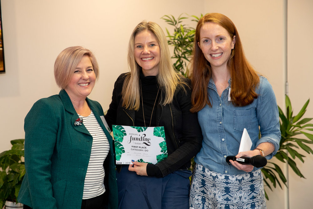 Bernadette (centre), is presented with her award by CEO chair of board, Rev. Jenni Stoddart (left), and ADM CEO, Dr Kate Harrison Brennan (right).