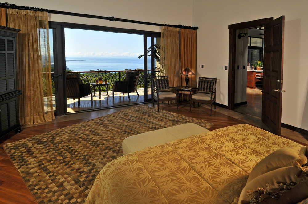 flex5-yoga-retreat-costa-rica-villa-king-suite-bedroom-view.jpg