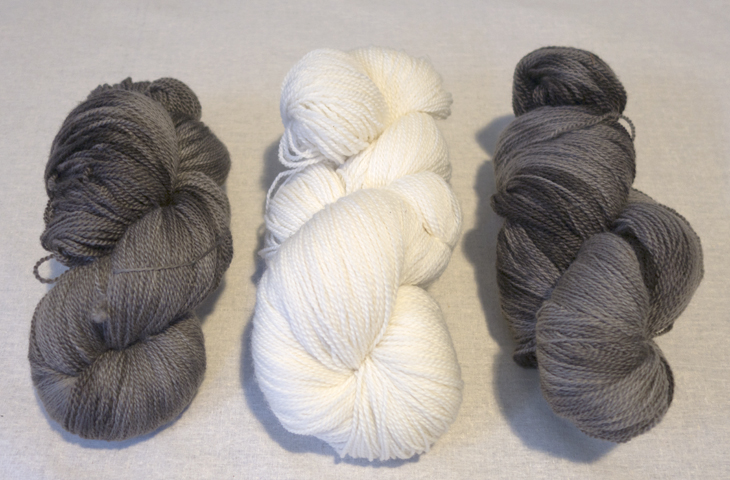 This is 8ply (DK) Polwarth yarn. The natural grey has been over-dyed with a bit of black. The white is un-dyed.