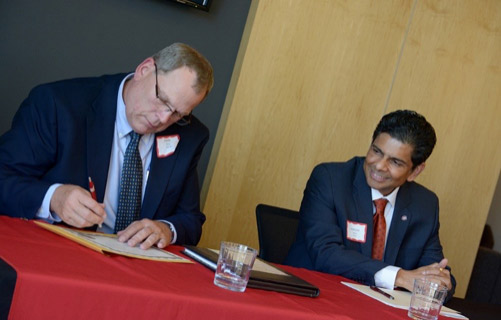 Grede General Manager John Haas and St. Cloud State Provost Ashish Vaidya sign the Minnesota Job Skills Partnership agreement at a signing ceremony in the St. Cloud State Welcome Center. [Source: University News, posted June 13, 2015 by Anna Kurth]