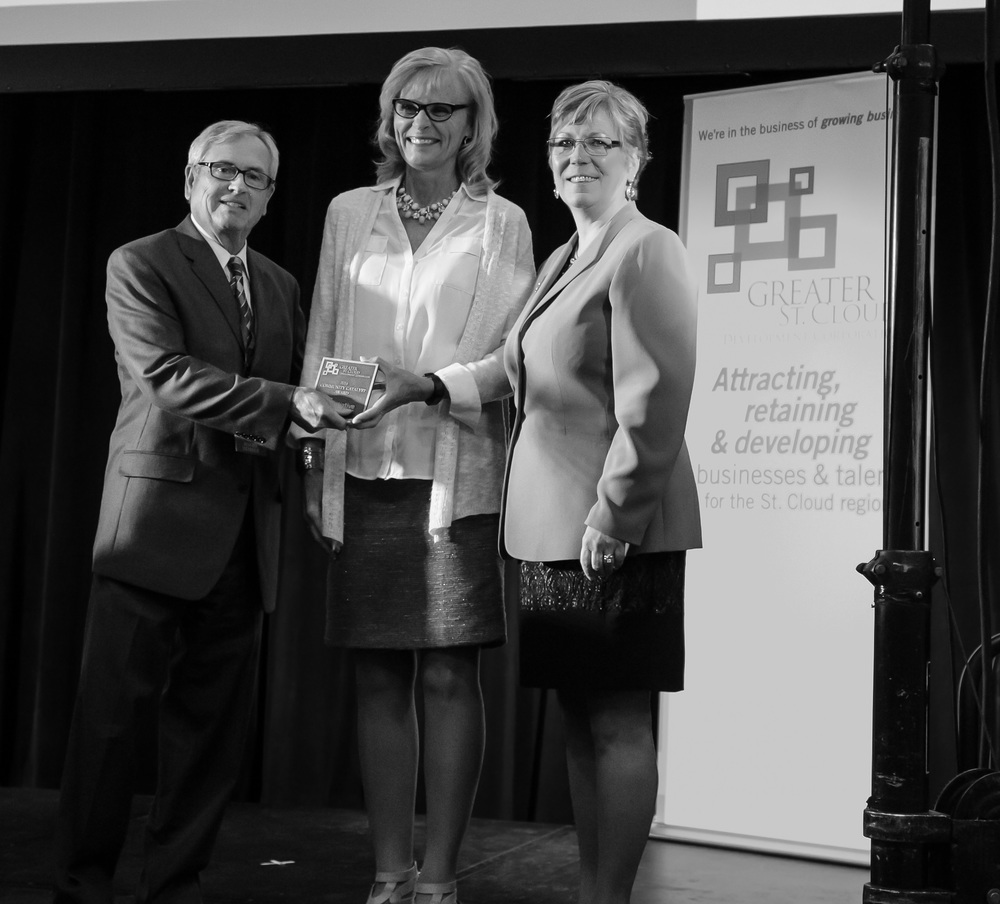 Initiative Foundation President Kathy Gaalswyk accepts the GSDC Community Catalyst Award from Bob White and Patti Gartland.