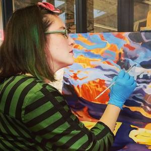 Heather Friedli painting in her studio, 2018
