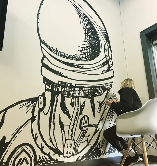 Huge shot to our amazingly talented friend @hannahjelden who's putting the finishing touches on the wall mural she took all the way from sketch to what you see here.  We couldn't be more excited to see it come fully to life but will definitely miss having her in the shop. Nice work, HJ! 📞(402) 325-1380 ✉️ info@inkalleyshirts.com • • • #art #paint #artist #painting #mural #walmural #design #sketch #handmade #artistsoninstagram #Murals #astronaut #painting #painted #create
