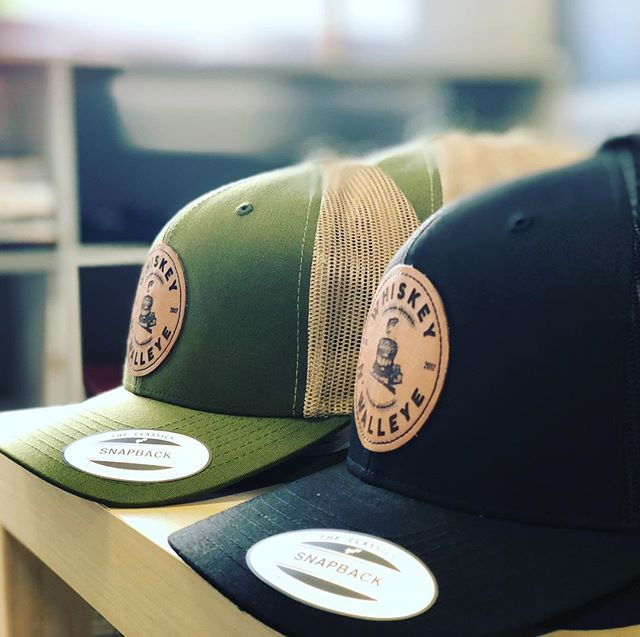 Leather patch snap backs - no doubt the hat of the summer. Shoutout to @whiskeynwalleye for working with us on this project. 📞 (402) 325-1380 ✉️ info@inkalleyshirts.com • • • #leather #leatherpatch #hats #caps #patch #hat #handmade #custom #design #graphicdesign #apparel #customapparel #screenprint #embroidery