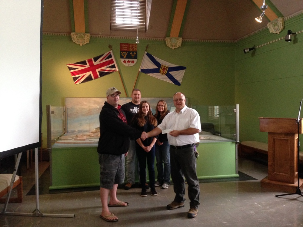 Members of Paranormal Investigations Nova Scotia donating a contribution to the Louisbourg Fortress Association