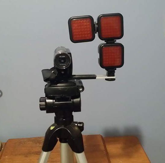 Infrared camcorder with three infrared floodlights attached - the floodlights cover a distance of about 50 feet.