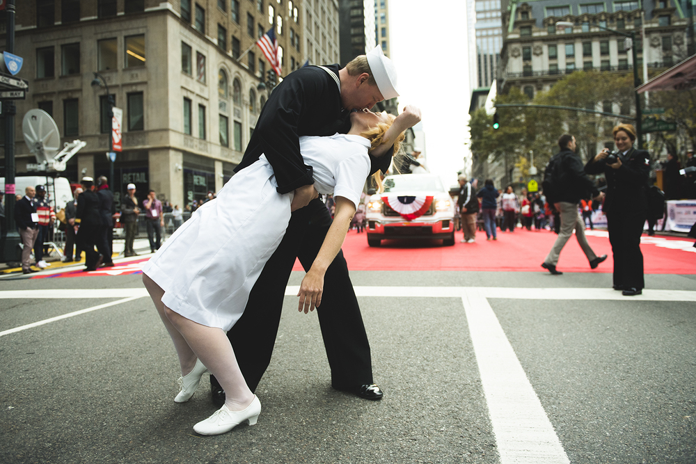 "marchers of Veterans Day Parade imitate an iconic ""kissing sailor"" on 5th Ave Manhattan, NY. 2015   ©    Go Nakamura     photography"