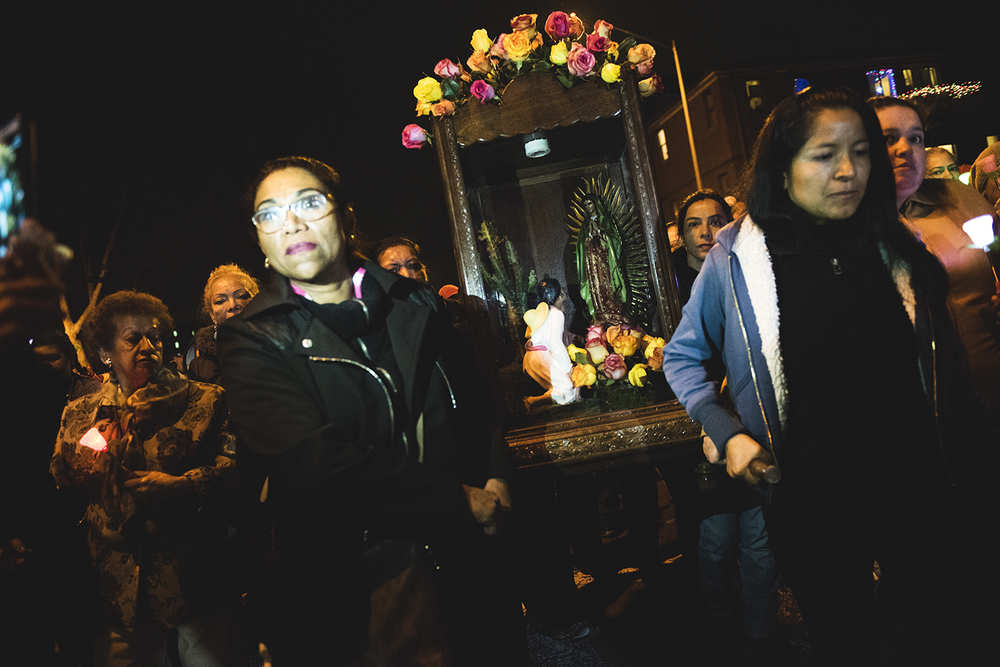 People carry a statue of Virgin Mary in a case to celebrate Feast of Our Lady of Guadalupe in Queens, NY. 2015  ©    Go Nakamura     photography