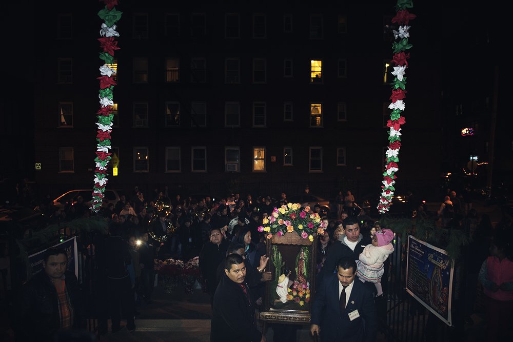 People carry a statue of Virgin Mary in a case to celebrate Feast of Our Lady of Guadalupe in Queens, NY. 2015©Go Nakamura photography