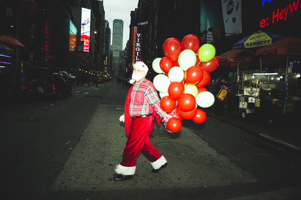 A man in Santa Costume for SantaCon. Manhattan, NY. 2015  ©    Go Nakamura     photography