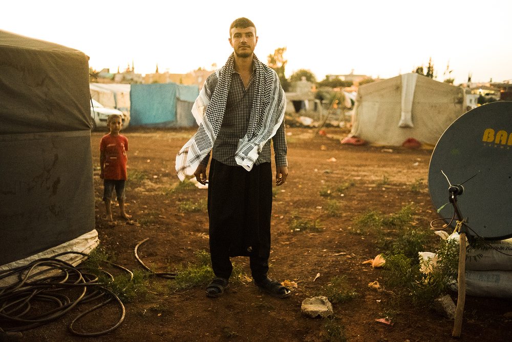 A Kurdish man at his tented village. Reyhanli, Turkey. 2015  ©    Go Nakamura     photography