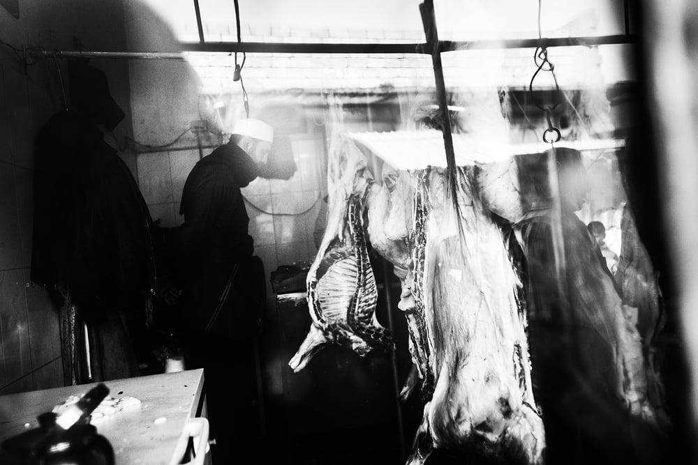 "a butcher, on the day of Eid al Adha ""Festival of the Sacrifice"". Tall Rifat, Syria. 2012 ©Go Nakamura photography"