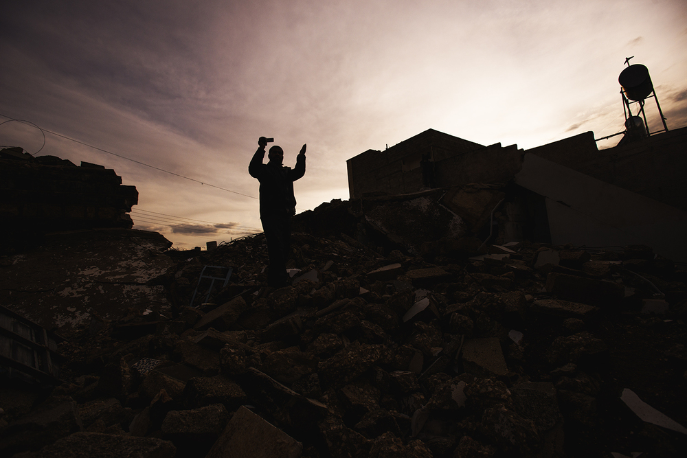 a Syrian man standing in the rubble. Tall Rifat, Syria. 2012   ©    Go Nakamura     photography