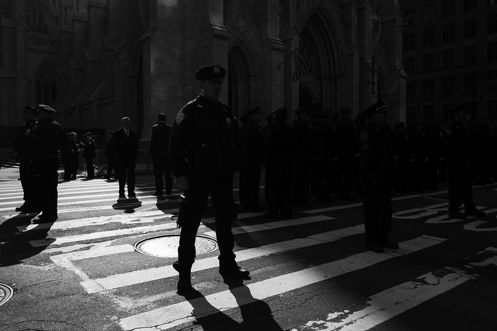 Officers lined up in front of St. Patrick's Cathedral for a memorial service of former NYPD officer David Hofer, who was killed in the line of duty in Texas. Manhattan, NY.  2016   ©    Go Nakamura     photography