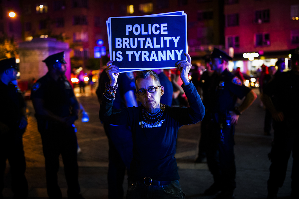 a protester against police brutality at Columbus Circle. Manhattan, NY 2016 ©Go Nakamura photography