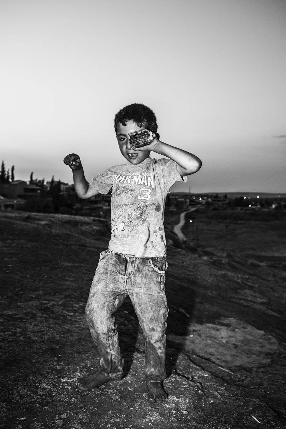 a Kurdish boy in his informal refugee camp. Reyhanli, Turkey. 2015 ©Go Nakamura photography