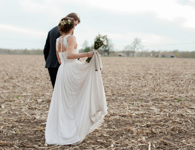 bride and groom in field.png