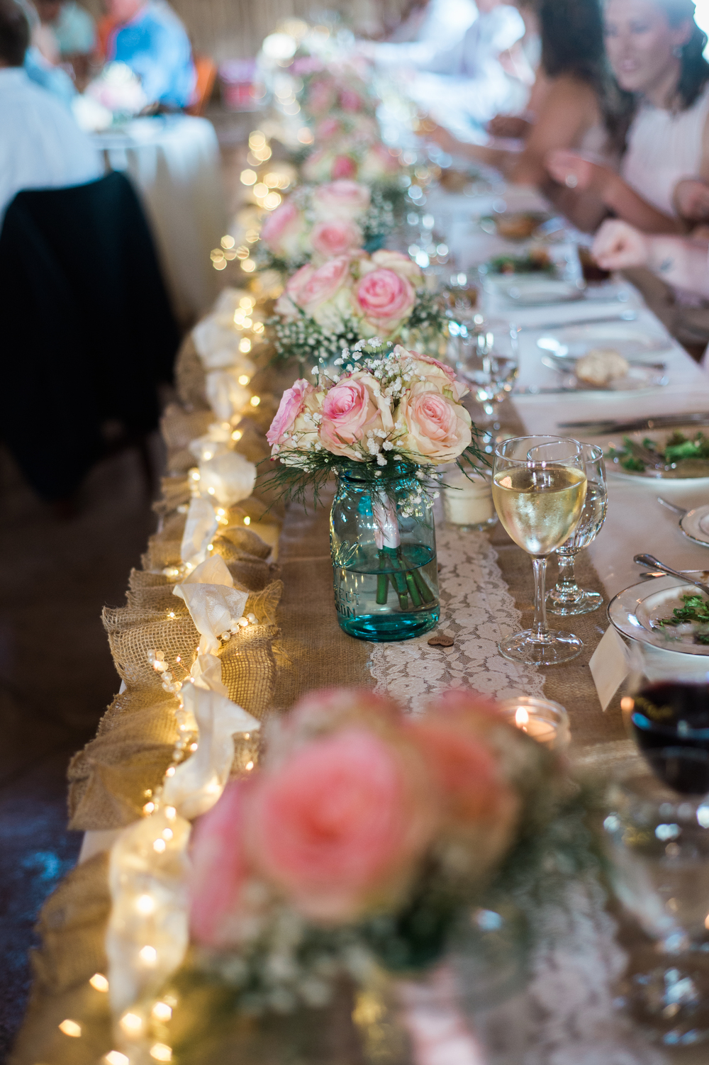 mason jars head table decor.jpg