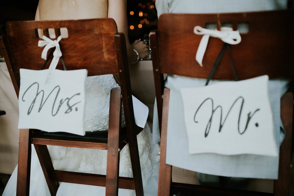 Mr. and Mrs. Chair signs wedding.jpg