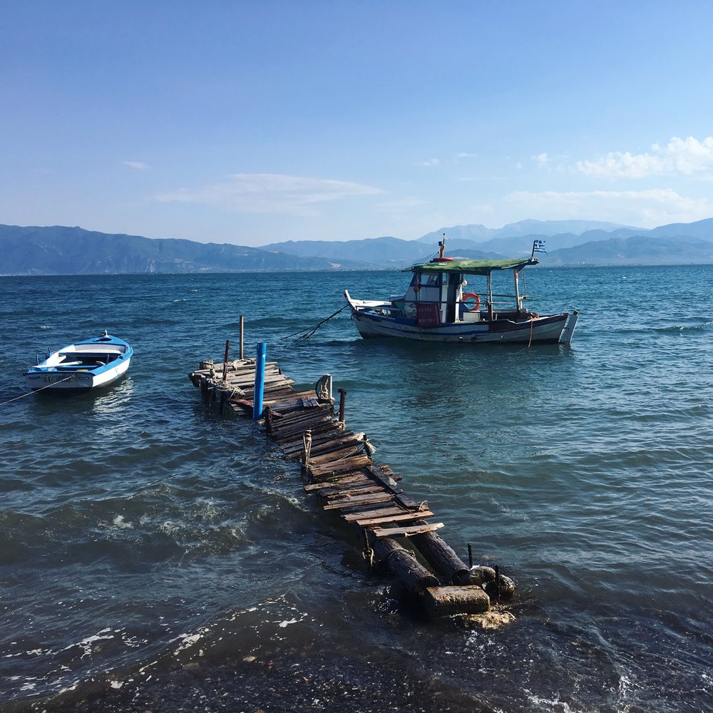 The wobbly-looking fishing boat piers of Karavomylos
