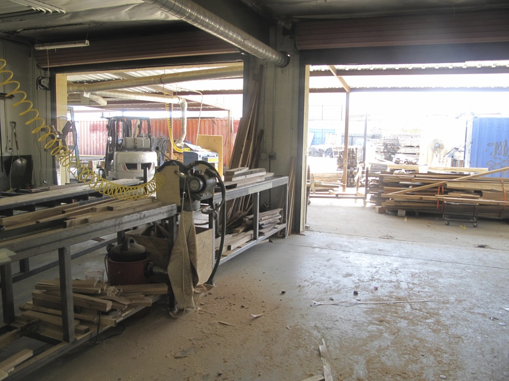 One section of the workshop, where wood was being prepped and furniture assembled.