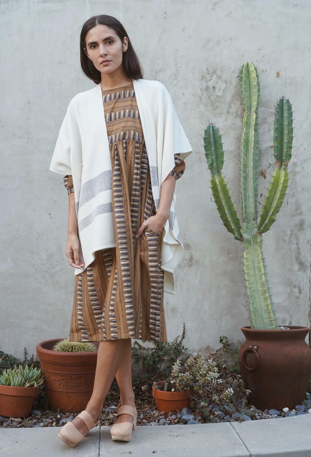 Kopal  Kuku Dress in Mustard Strip +  Maiyet  Stripe Hem Poncho in Ivory +   Zuzii   Closed Toe Clogs in Natural.