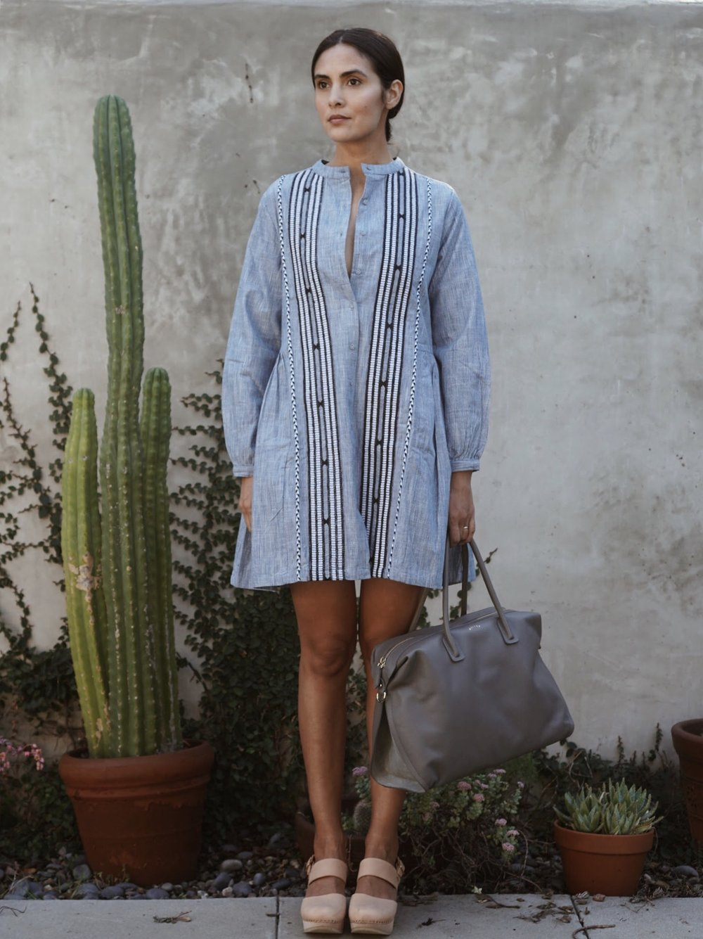 Kopal  Riya Dress in Indigo Stripe +  Maiyet  Como Large Satchel in Grey +   Zuzii   Closed Toe Clogs in Natural.