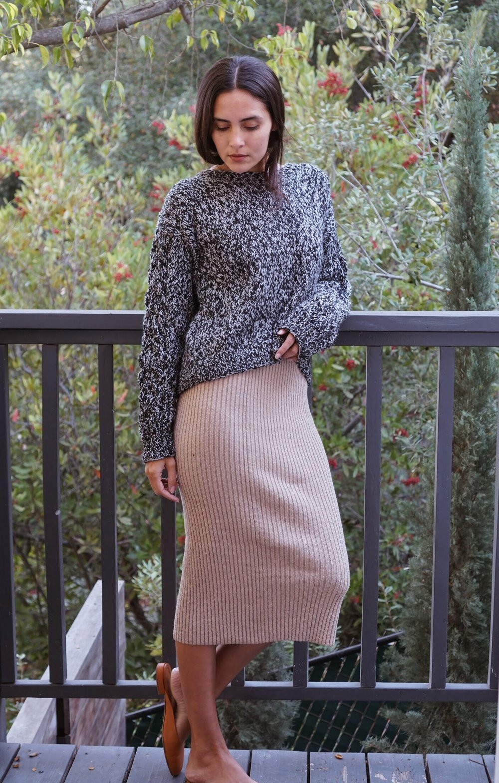 Voz  Cable Boatneck in Black/Opal +  Eleven Six  Rib Tube Skirt in Nude +  Maiyet  Sia East/West in Cognac.
