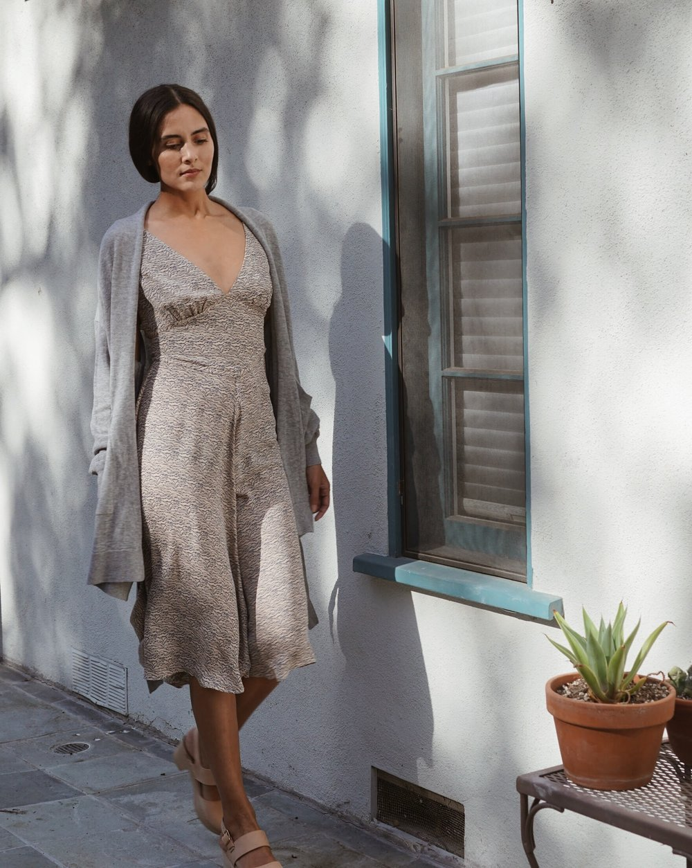 Olga Kapustina  Silk Georgette Slip dress in Print +  Maiyet  Wrap Cardigan in Grey +   Zuzii   Closed Toe Clogs in Natural.
