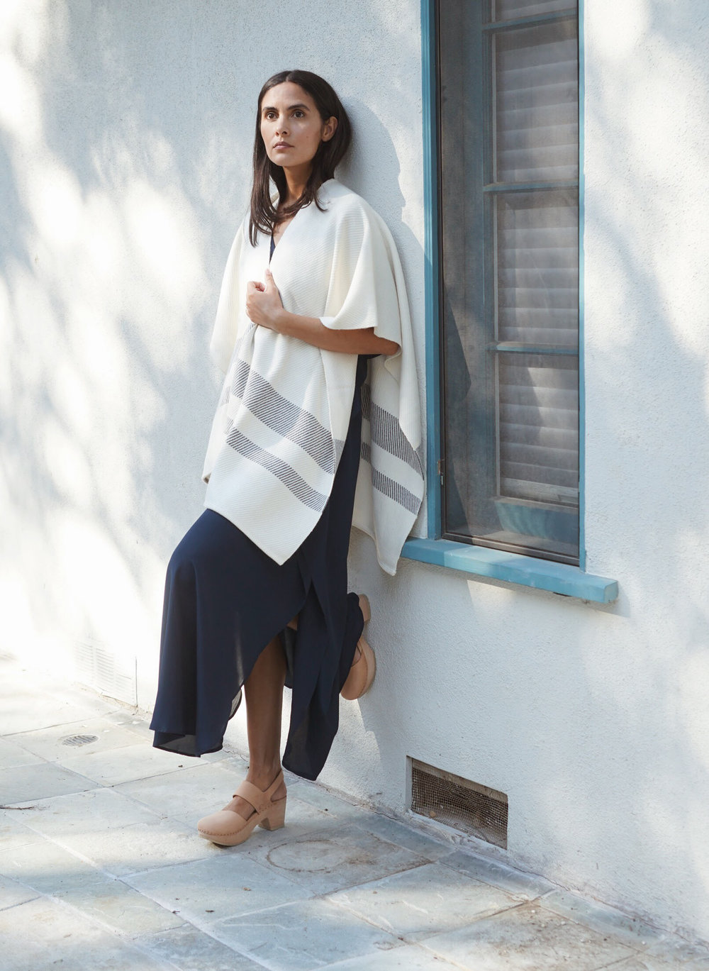 Maiyet  Stripe Hem Poncho in Ivory +  Raven & Lily  Fiza Dress in Navy +   Zuzii   Close Toe Clogs in Natural.