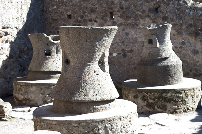 Stone cylinders spun by donkey power to mill grain
