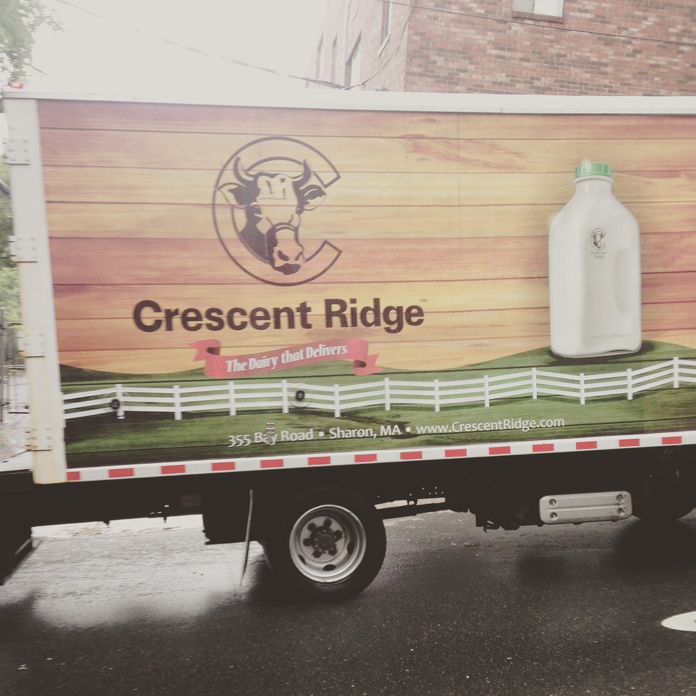 Mid day milk delivery in Boston neighborhood.