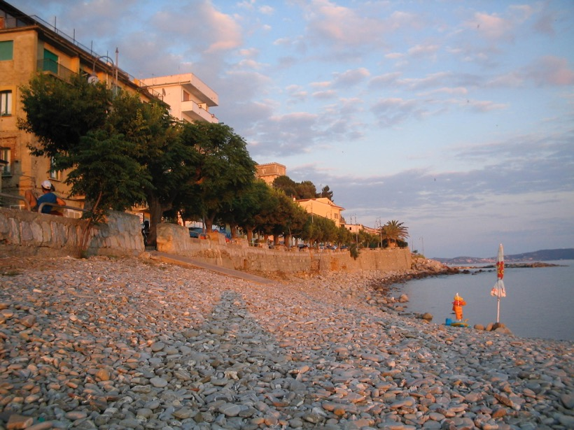 Marina di Pisciotta's waterfront at sunset.