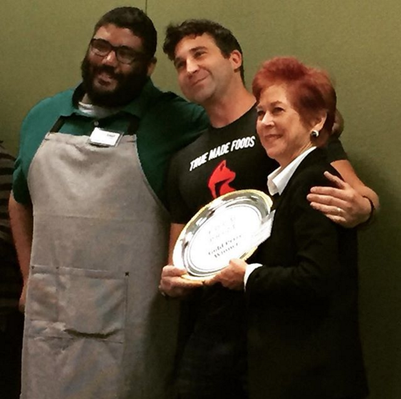 Abe and Kevin of True Made Foods with Robyn Metcalfe, accepting the Gold Prize