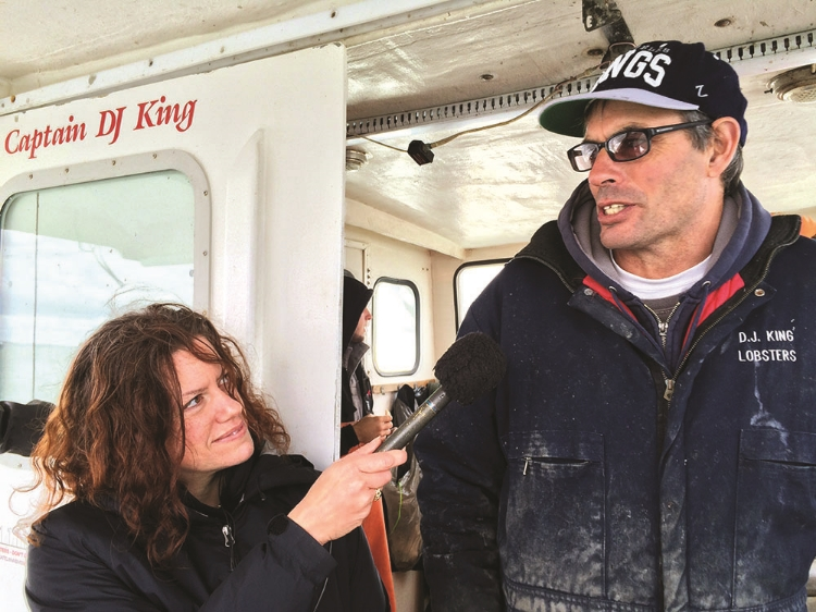 """Kelp farmer D. J. King talks to Gastropod co-host Cynthia Graber aboard his boat for the Gastropod episode """"Kale of the Sea.""""Photo by Nicola Twilley"""