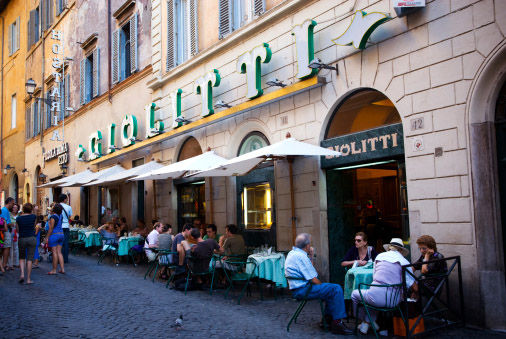 Outdoor seating at Gelateria Giolitti on Rome's Via Uffici del Vicario near the Pantheon.